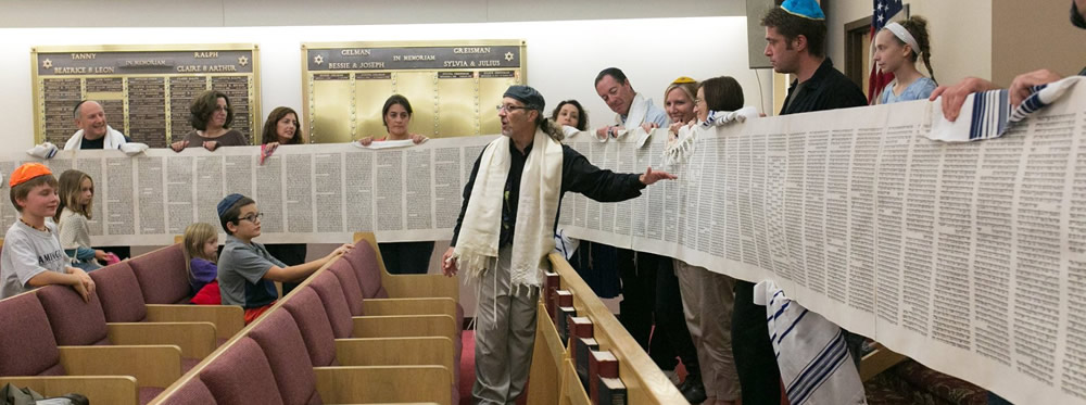 Rabbi Micah shows Torah Scroll on Simchat Torah
